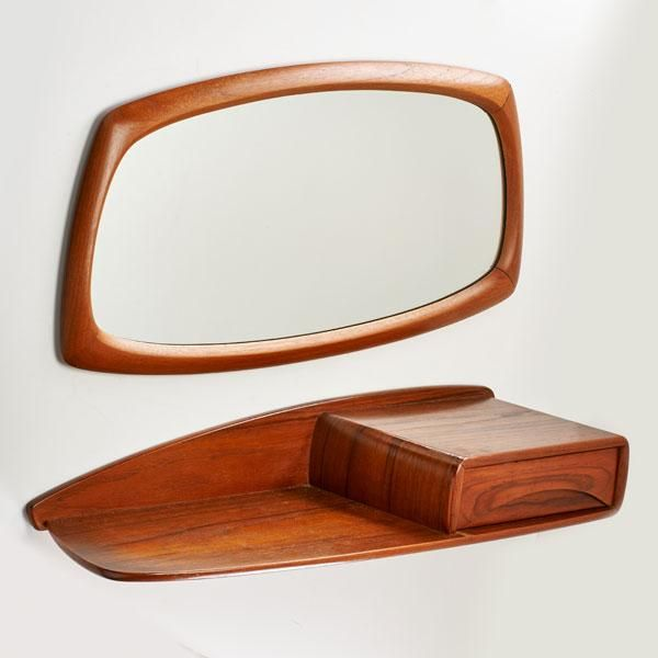 "Bid now or live on 8/28  |  E.M.T Single-drawer wall hanging shelf and matching mirror, #Norway, ca. #1970, #Teak and mirrored #20th #Century #Design, Marked ""Elverum Mobel Trevarefabrikk"" @ragoauctions #modern #wood"