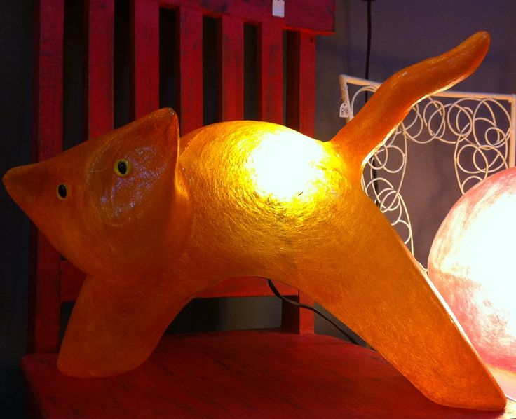Lighting fixture in the shape of a cat that curbs its back, made out of fiberglass. It can be put on the floor or on any surface, even on carpeted or wooden floor.  Fiberglass material is robust and unbreakable, at the same time as being very light -almost weightless.  It is ideal for any room , especially the children's room. It can be used as a stylish night-light, or just decorate and brighten the space at any time. Children can play with the lamp and it will not cave in!