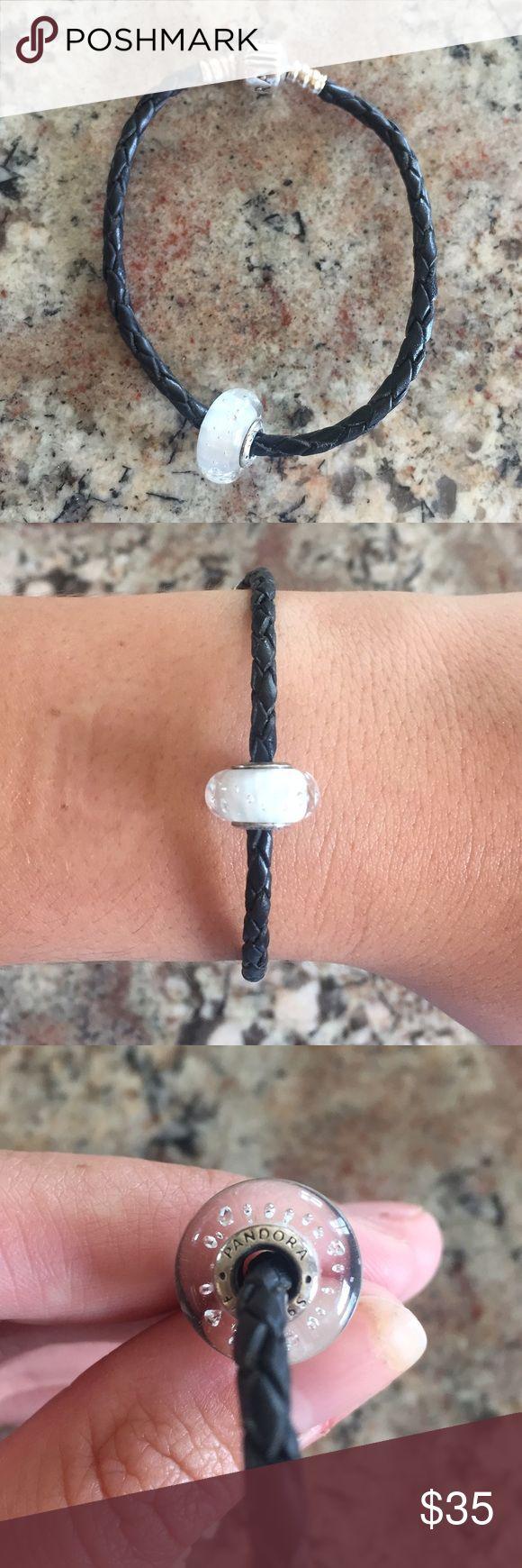 Pandora Bracelet Gently used black leather rope Pandora bracelet WITH beautiful glass bead. Originally an $80 value!! Feel free to make an offer. Pandora Jewelry Bracelets