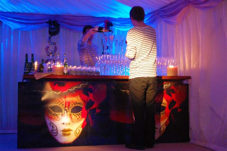 Bar decorated with Venetian Carnevale masks for a Venice themed party