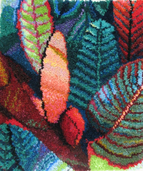 """The work was created by hooking wool on a canvas net and it dimensions are 30""""(76cm)length x 27""""(67cm)width ."""
