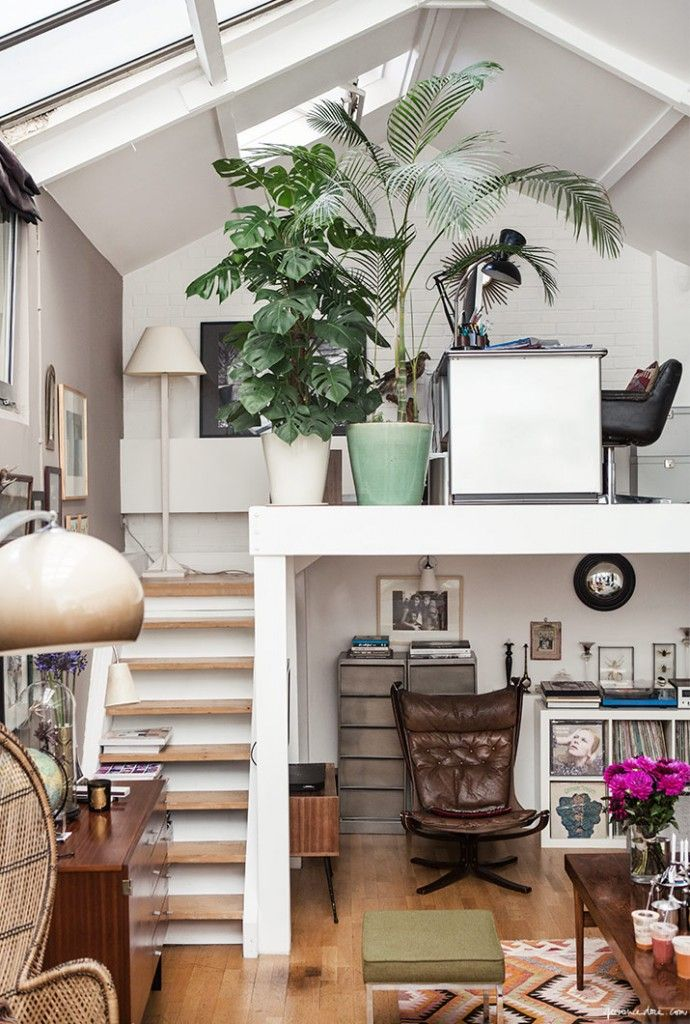 The adorable, lived-in look of this all-white tiny space gets my vote. I love the open loft with the giant philodendron and skylight, as well as the album covers down below, next to that comfy leather chair. marine braunschvig photo | Tiny Homes