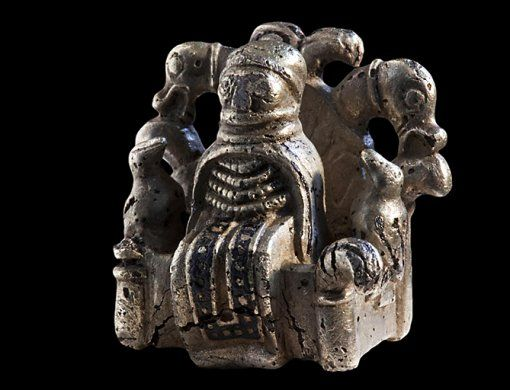 """ilver figurine of Odin from Lejre, Denmark - circa late Iron Age / Viking Age.  """"That it is the… Æsir's supreme god who is depicted, is clearly shown by the two birds sitting on the armrests of the chair. They are Odin's two ravens, Hugin and Munin, that flew out every day and returned home in the evening to tell Odin all that had happened…."""""""