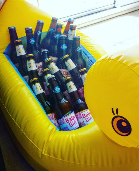"blow up bath duck to use as a cooler at a baby shower with ""baby girl"" labels around the beer. perfect for a couples shower"