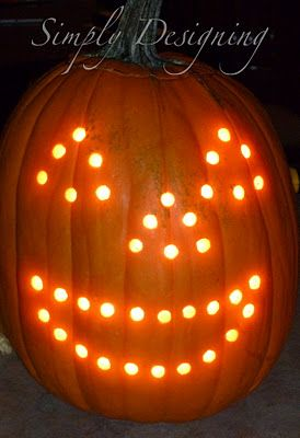 Pumpkin carving with a Drill.  Used Christmas lights to light it.  Love carving pumpkins with power tools!  It is so easy and so much fun!