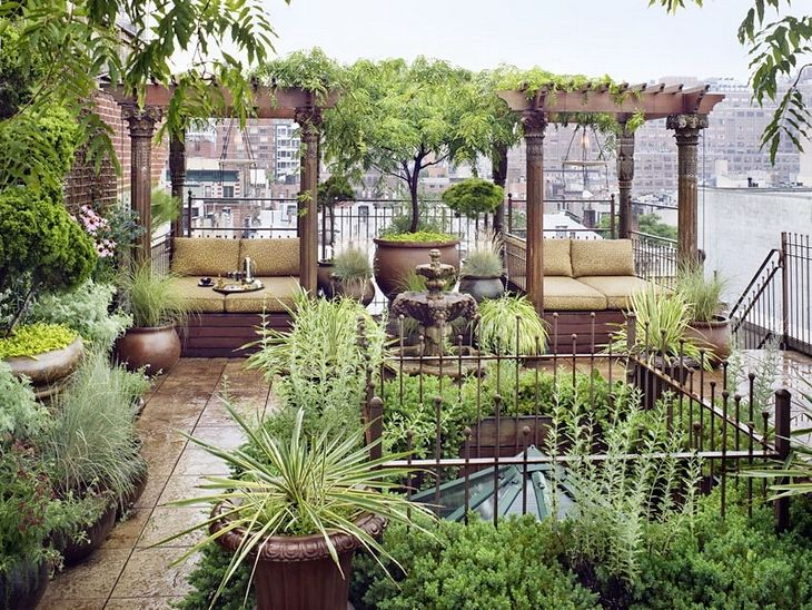 This rare private garden oasis is nestled atop this duplex penthouse loft