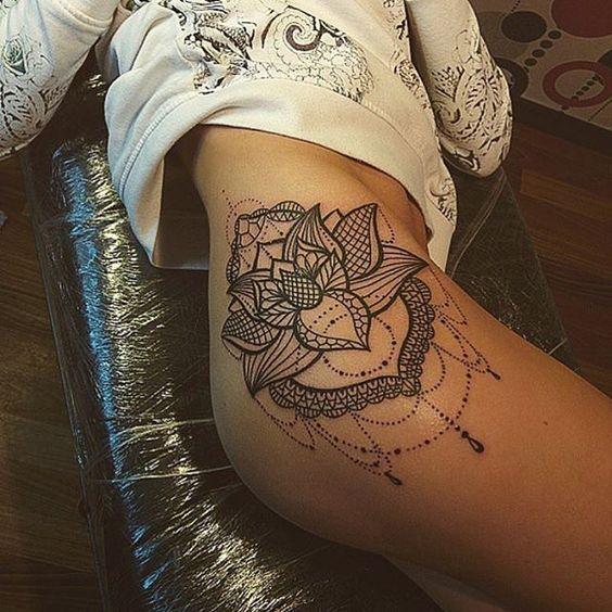 Delicate lotus mandala hip tattoo.