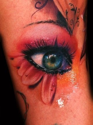 artist's ability to draw eyes.. tattoo gun!!!