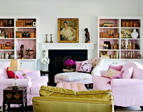 Pink Living Room:   Pink, used as a neutral here, blossoms on couches, pillows, and in vintage wallpaper-lined bookshelves. An antique gilded picture frame balances the gold silk taffeta chair across the room. The Chinese lacquer table grounds the pink and white furnishings.