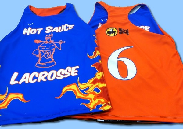 Girls lacrosse pinnies are made to order in Maryland USA by Lightning Wear.  Hot sauce lacrosse is looking sassy in these.  Design yours online.