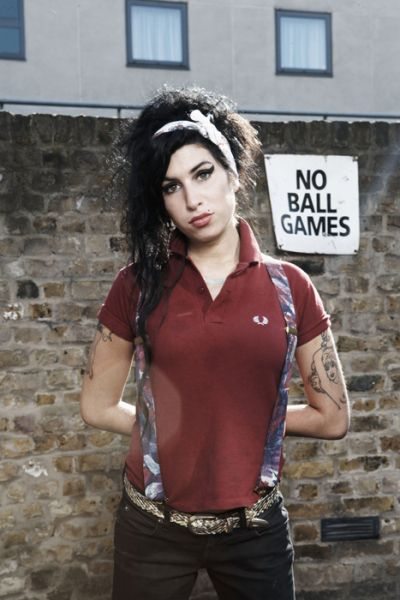 Amy Winehouse in a Fred Perry polo shirt and braces