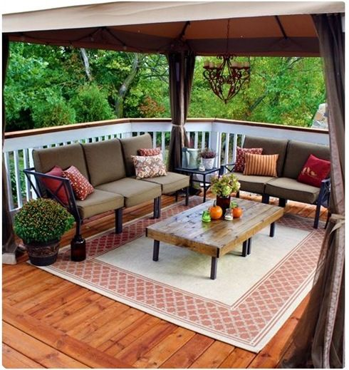 Love the idea of adding an area rug to an outdoor living area - if we screened in our top deck this would be a great addition