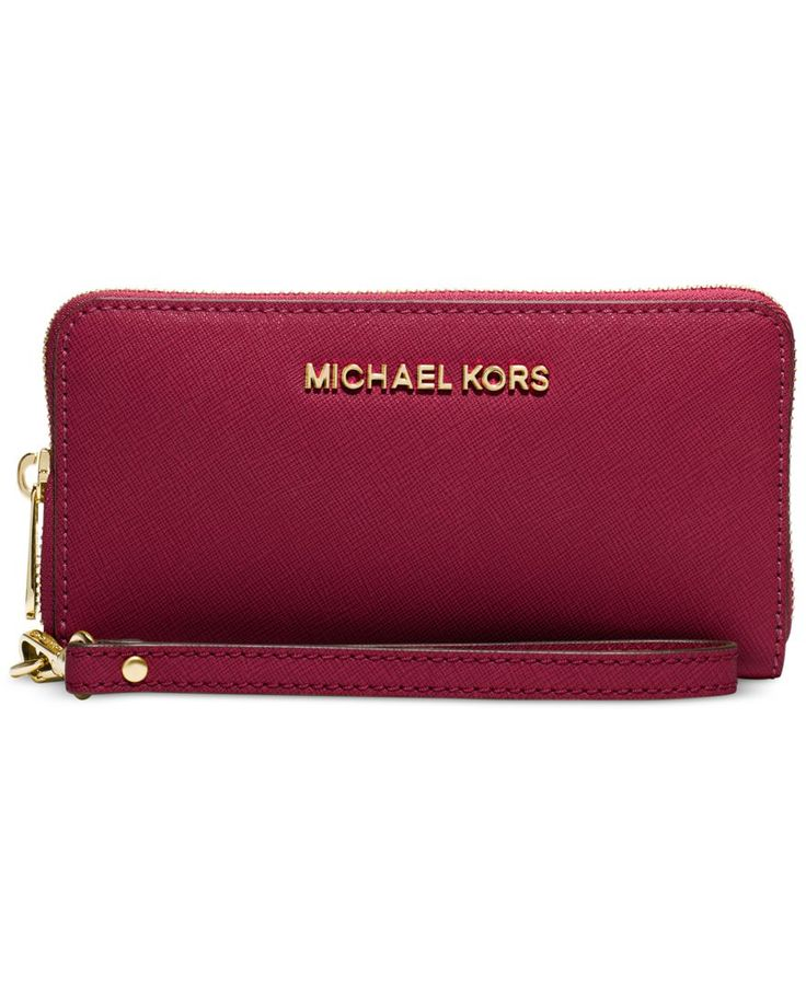 Keep your cards, currency and cellphone in check with this sleek leather wallet from Michael Michael Kors. Dressed with signature lettering, multiple pockets offer superb organization within. | Leathe