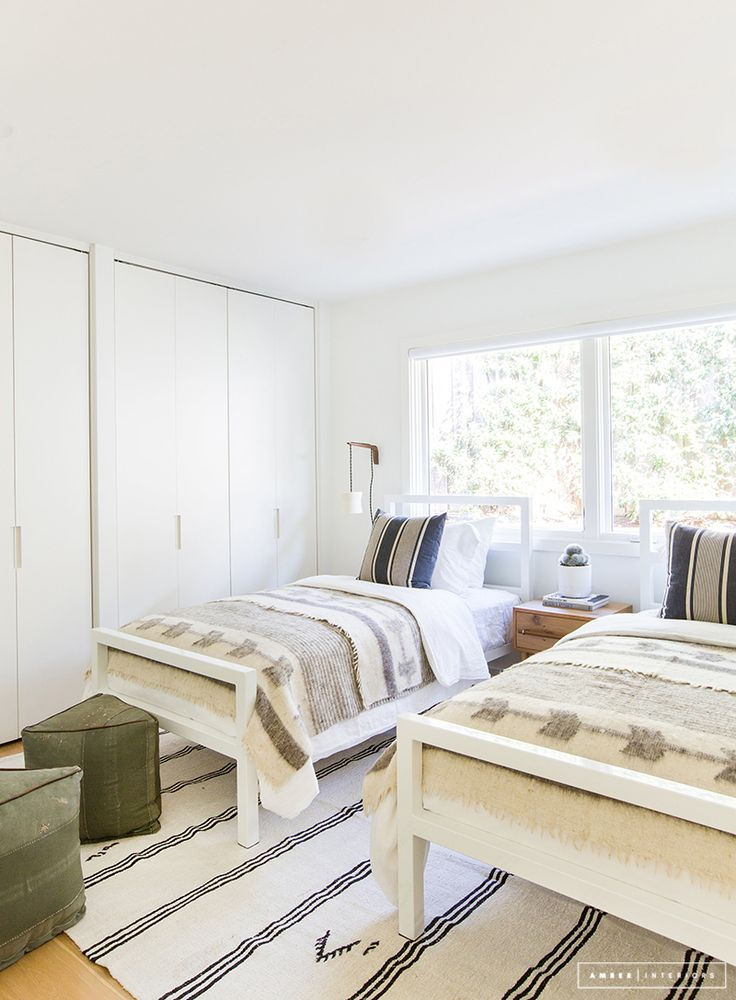 Minimalist Mid-Century bedroom with two beds