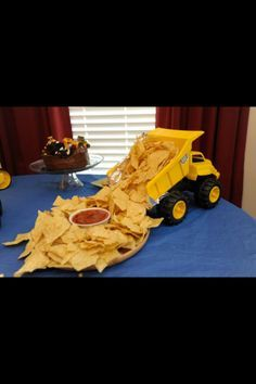 Dump truck with chips...kids party ideas. I assume it to be a new truck, not the one that's currently full of muddy water. ;) jm