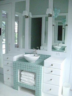 A perfect spot for storing towels in master bath by Molly Frey. This is one of two sink vanities that are opposite of each other.