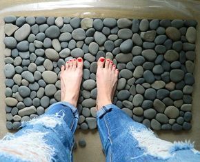 Bring the outdoors in with this money-saving project. All it takes are some smooth rocks, which shouldn't be too hard to find, an outdoor rubber mat, and clear, waterproof silicone sealer.