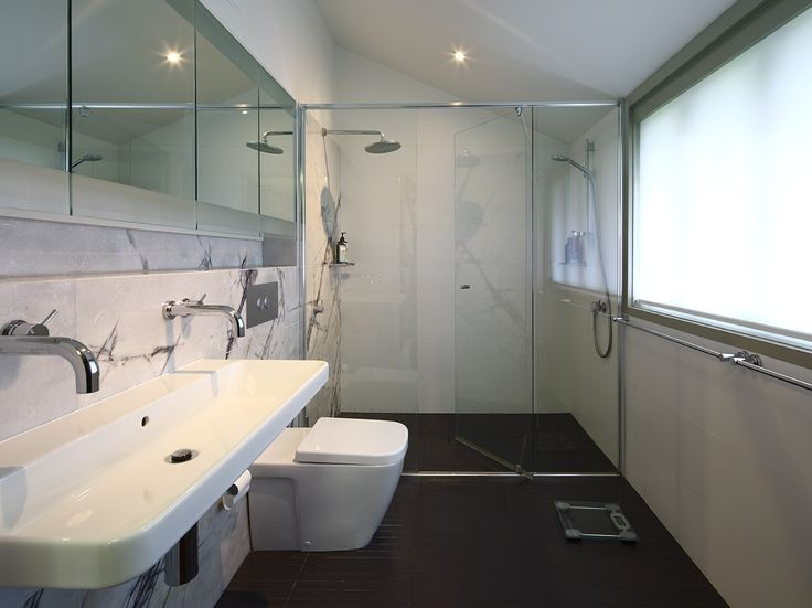 Bulimba House: Bathroom with large frosted glass window for natural light and privacy. See more at http://blighgraham.com.au/projects/bulimba-house-1
