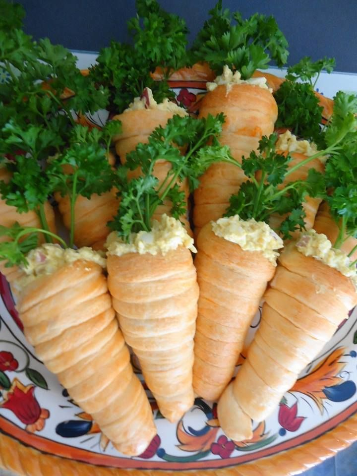 Check out this cute idea to serve egg salad...form your crescents like a cone and bake...then stuff with egg salad and top off with parsley...they look like carrots!