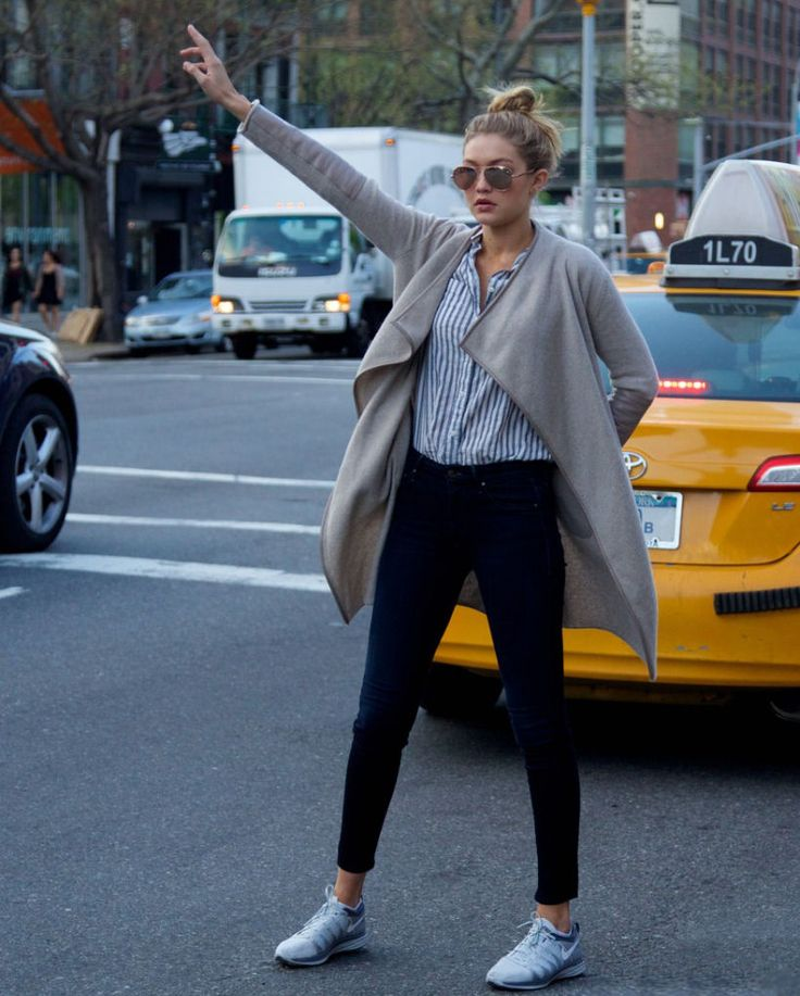gigi hadid athleisure street style - long, open sweater, button up blouse, jeans + nikes