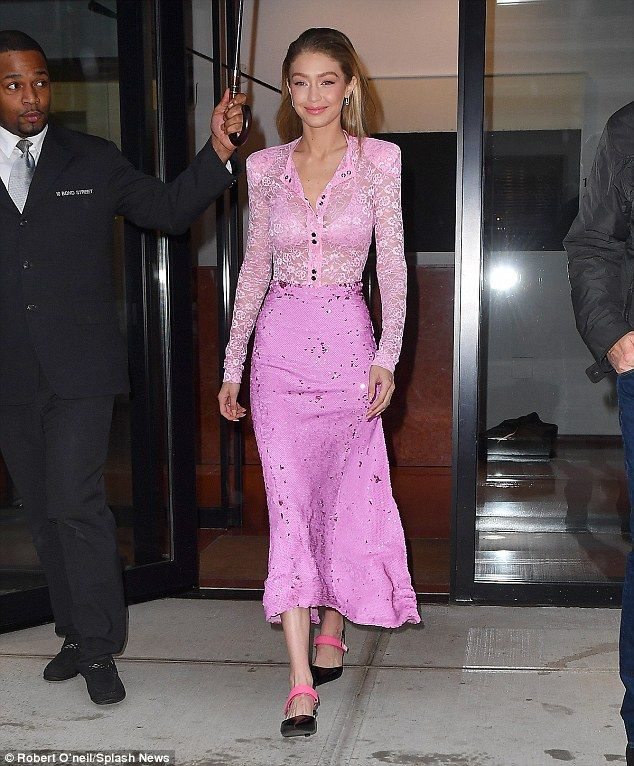 Racy; Gigi Hadid looked on top of the world as she made a very glamorous- and pink- exit f...
