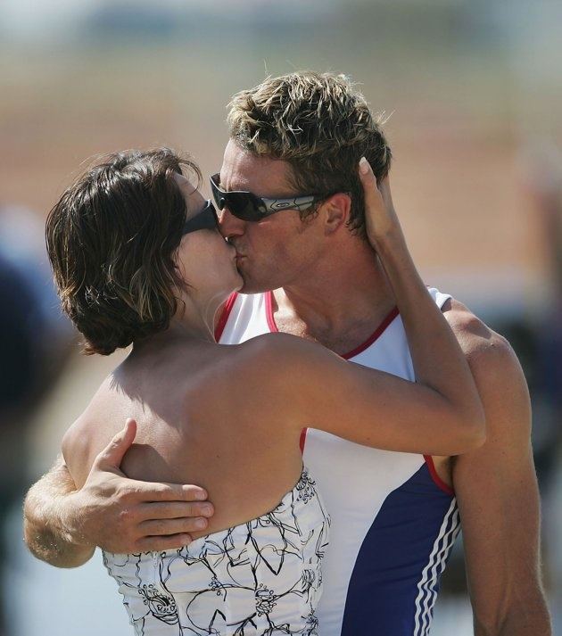 Inspirational Moments: Olympic celebrations - James Cracknell of Great Britain kisses his wife Beverly Turner after receiving his Gold medal for the men's four rowing event on August 21, 2004 during the Athens 2004 Summer Olympic Games at the Schinias Olympic Rowing and Canoeing Centre in Athens, Greece. (Photo by Shaun Botterill/Getty Images)