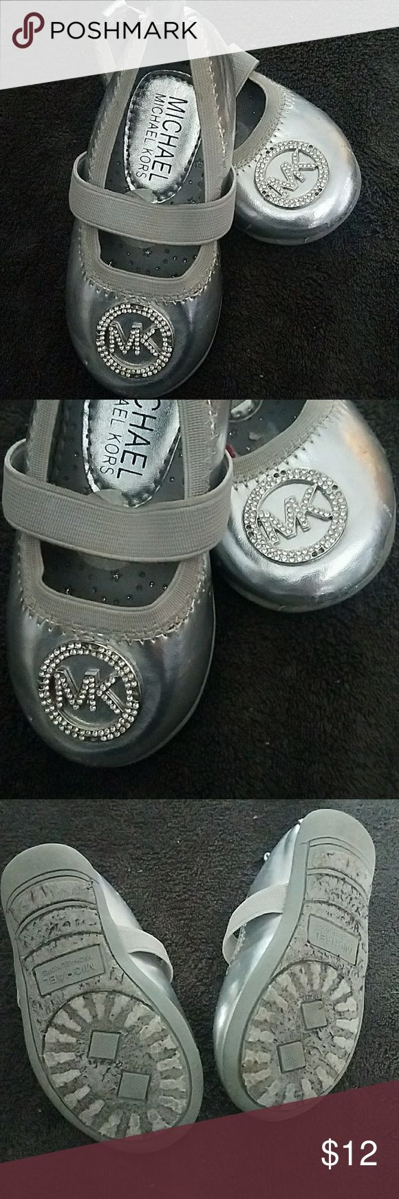 MK Toddler Shoes Very cute Michael Kors silver ballet flats. A few missing rhinestones on both shoes as shown in close up picture. Michael Kors Shoes Baby & Walker