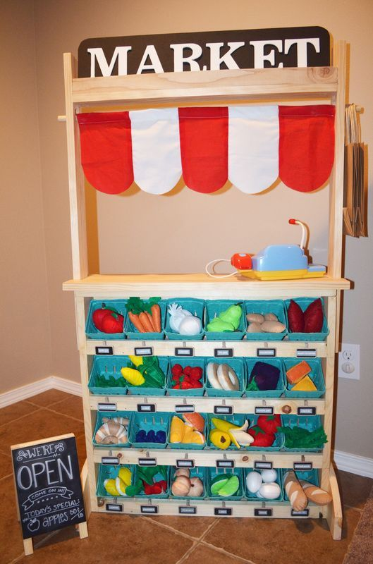 DIY Play market, grocery store, puppet theater, lemonade stand, bakery, restaurant, cafe, pet shop. Building plans and photo tutorial for the best toddler role play prop ever!