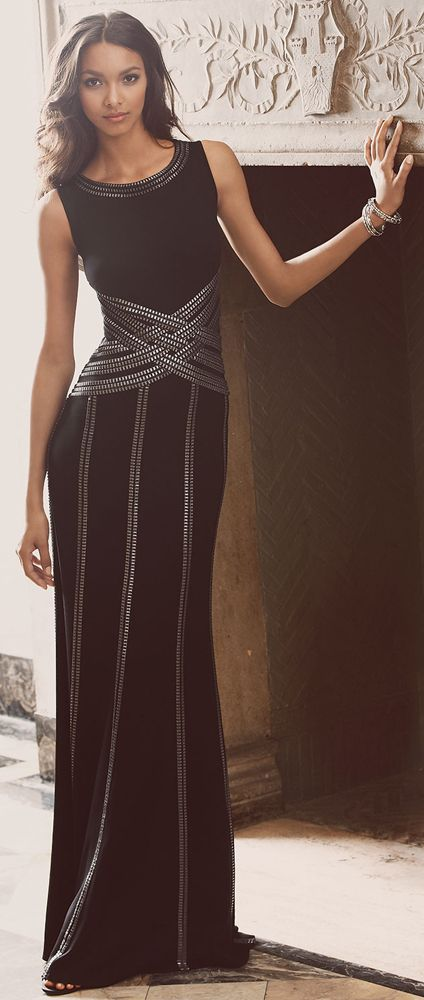 TADASHI SHOJI Sleeveless Gown with Ribbon Striping.  Metallic, chain-look ribbon strategically wraps and stripes this elegant Tadashi Shoji gown to figure-flattering results. To complete your look, carry a metallic minaudiere.