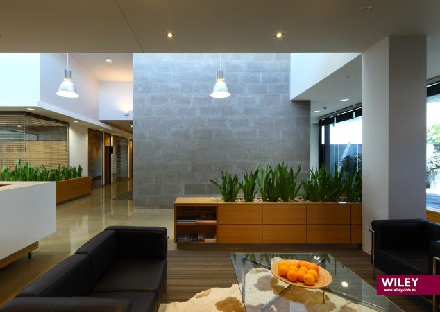 Level 3 is the public face of the company. A reception lounge with a view to a landscaped courtyard was created; the main axis of the space, an internal 'urban street'. The urban scale was created to give a sense of public space where visitors can relax without feeling they are intruding in office space. #wiley