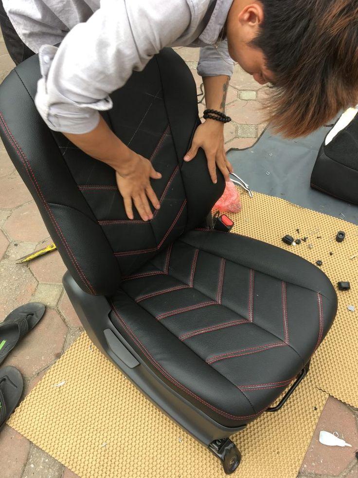 Bọc ghế trước xe ô tô ISUZU DMAX tại gara ISUZU Long Biên cho khách.