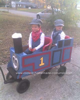 Homemade DIY Thomas the Train Halloween Costume: My twin sons are obsessed with Thomas the Train. So, we took an old broken down wagon and made it into a giant Thomas for them to ride in while dressed