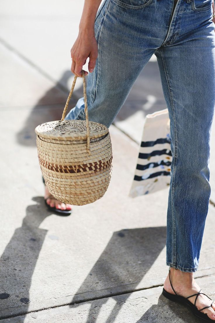100+ Outfits We're Copying From The Streets Of New York City #refinery29  http://www.refinery29.com/2016/09/120553/nyfw-spring-2017-best-street-style-outfits#slide-69  Are basket bags ever not wildly photogenic?...