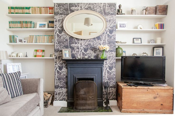 Wallpapered fireplace and vintage penguin books