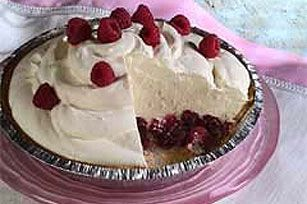Luscious Cheesecake Pudding Pie~ A luscious layer of both fresh raspberries and preserves is topped with prepared cheesecake pudding mix in this no-bake graham cracker crust pie.