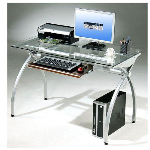 Techni Mobili Glass Top Computer Desk, Clear by Techni Mobili. $132.23. The modern style of this Techni Mobili Glass-Top Computer Desk brings a crisp and smart ambiance to any office. It features a heavy-duty 8 mm tempered safety glass desktop, the stylish lines of a curved scratch-resistant powder-coated steel frame and a pull-out keyboard shelf with moisture resistant PVC laminate veneer in a Mahogany finish. With its compact footprint you can furnish your worksp...