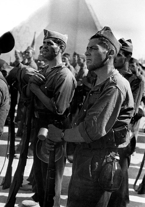 Spain - 1937. - GC - Brunete. Republican soldiers standing with their guns. July…