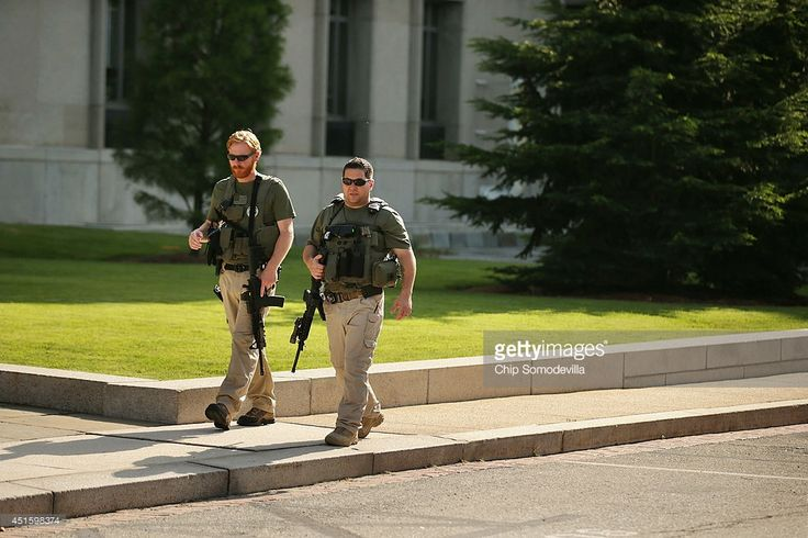 Marshals patrol the outside of the Prettyman Federal Court Building where Ahmed Abu Khattala, one of the suspected ringleaders of the 2012 attacks in Benghazi, Libya, is being held before his pretrial detention hearing July 2, 2014 in Washington, DC. Abu Khattala was seized June 15 in Libya by U.S. Special Operations forces, 21 months after U.S. Ambassador Chris Stevens and three other Americans were killed during an attack on U.S. facilities in Benghazi.