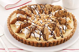Easy Peanut Butter-Chocolate Chip Pie:   1 pkg.  (16.5 oz.) refrigerated chocolate chip cookie dough, divided 1 pkg.  (3.4 oz.) JELL-O Vanilla Flavor Instant Pudding 1 cup  cold milk 1/3 cup  PLANTERS Creamy Peanut Butter, divided 1-1/2 cups  thawed COOL WHIP Whipped Topping 1 oz.  BAKER'S Semi-Sweet Chocolate 2 Tbsp.  chopped PLANTERS COCKTAIL Peanuts