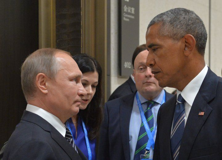 Russian President Vladimir Putin (L) meets with his U.S. counterpart Barack Obama on the sidelines of the G20 Leaders Summit in Hangzhou on September 5, 2016.