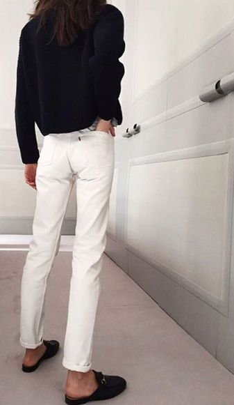 Black and white outfit inspiration re-imagined: White denim jeans pop when paired with a cozy black sweater and Gucci loafer slides.