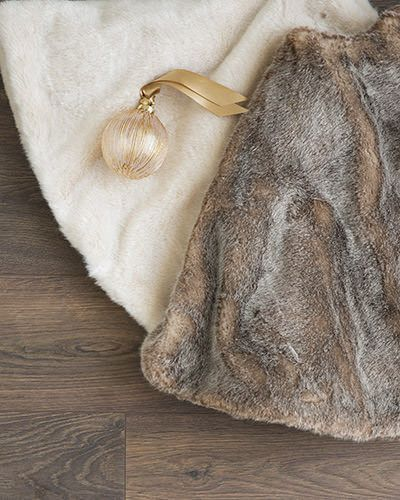 The luxurious faux fur of Balsam Hill's Lodge Faux Fur Tree Skirt mimics the softness of its natural counterpart, created in a beautiful shade that adds depth to the fabric.