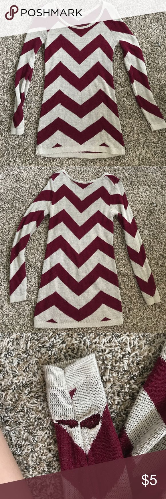oversized sweater dress Zig zag design, burgundy pink color contrasted with the cream. Has some worn shown in the pictures and pilling, but still can be worn as a cute going out dress in the winter! 100% acrylic Charlotte Russe Dresses