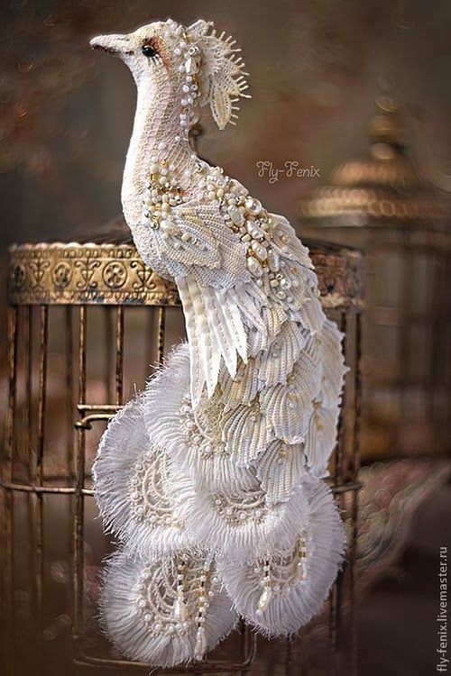 White Peacock. Russian artist Julia Gorina hand makes these miniature birds and owls textile brooches using vintage fabric and laces that are hand painted and meticulously embroidered.