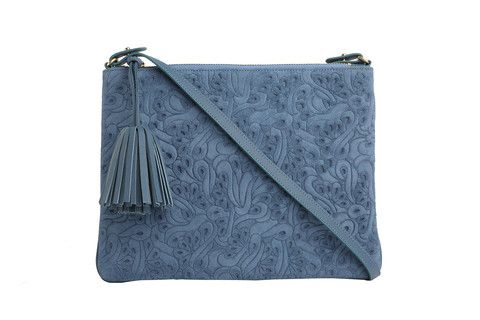 Crossbody Editors Pouch Flower Party in blue.  Executed in a monochromatic graphic floral, this pouch plays well with other prints.  Sling it crossbody, or tuck this versatile bag under your arm like a clutch.