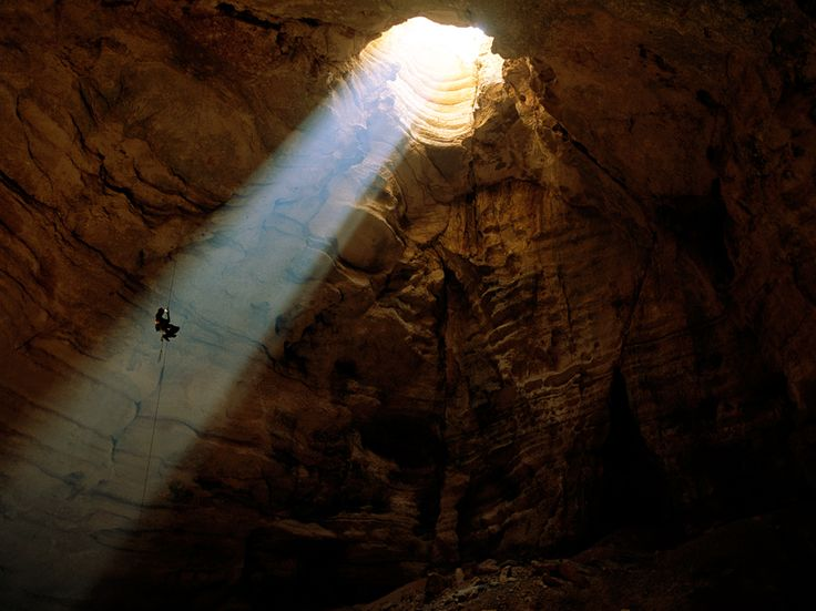 Exploring the Majlis al Jinn—one of the largest cave chambers in the world—requires some high wire rappelling. There is a 518-foot drop to the bottom of the chamber.    Photograph by Stephen Alvarez, National Geographic