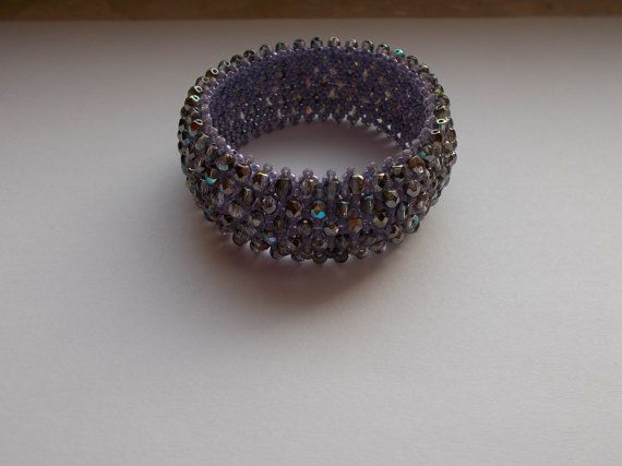 Check out this item in my Etsy shop https://www.etsy.com/listing/494414620/violet-caprice-bracelet