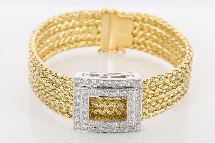 Five woven strands of 18k yellow gold held together with a beautiful diamond square. So comfortable and so wearable day or night. Available at www.1stdibs.com/dealers/the-jewellery-trading-company/