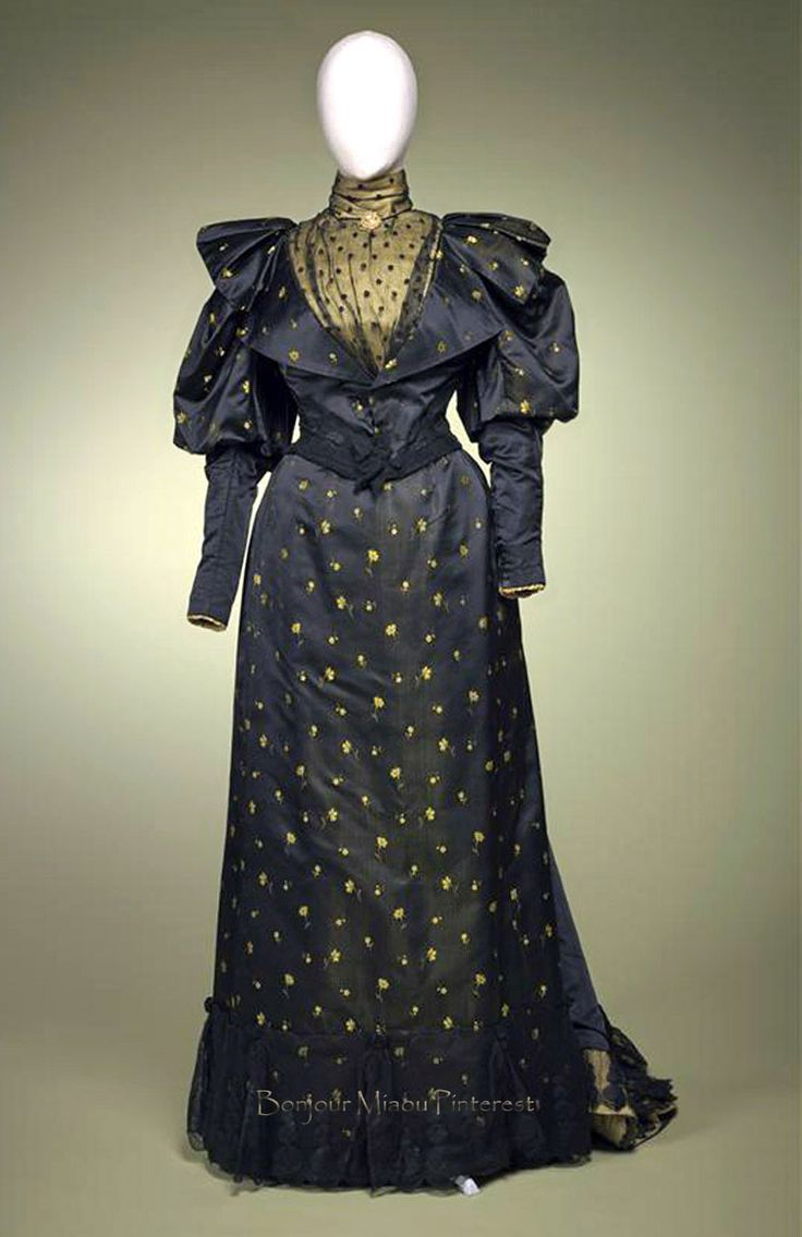 Afternoon gown, two pieces. Black satin with woven yellow flowers; garnish of black tulle and yellow satin. Gemeentemuseum Den Haag via Europeana Fashions