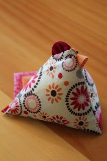 SPRING CHICKS. This gal makes the 2 square chicken pincushion using bits of folded fabric for the trim. Cute! Life in a Little Red Farmhouse: Chicken Pin Cushion Tutorial & Giveaway